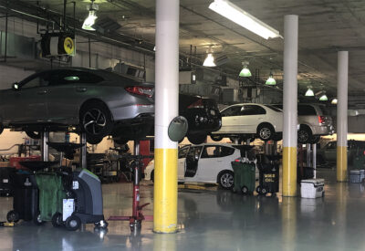 Cars being worked on at auto shop