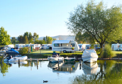 Camping site on a lake with RV's and Boats